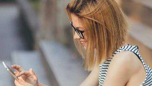 mulher acessando no celular nota do enem